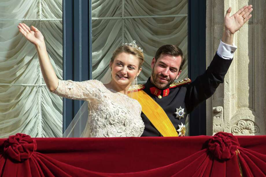 Luxembourg's Prince Guillaume and Countess Stephanie wave from the balcony of the Royal Palace after their wedding in Luxembourg, Saturday, Oct. 20, 2012. Photo: Geert Vanden  Wijngaert, Associated Press / AP