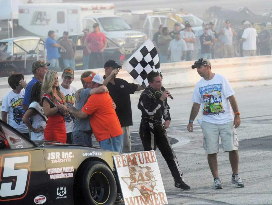 Race winner Hunter Montgomery addresses the crowd as his family, friends and crew celebrate at the San Antonio Speedway on Texas Highway 16 South on Saturday, Oct. 20, 2012. The 35-year-old half-mile track has not hosted a race since 2007. Photo: Billy Calzada, Express-News / © 2012 San Antonio Express-News