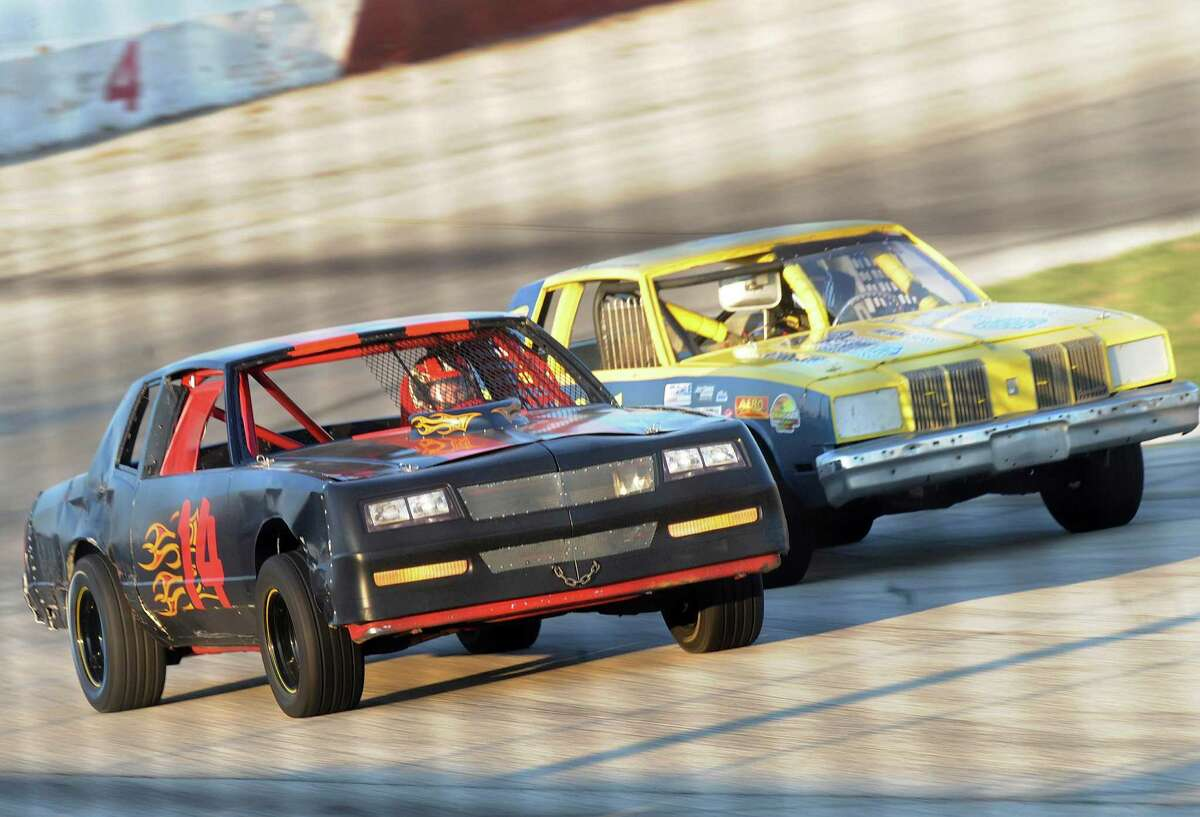 Late-model modifieds race side-by-side at the San Antonio Speedway on Saturday, Oct. 20, 2012.