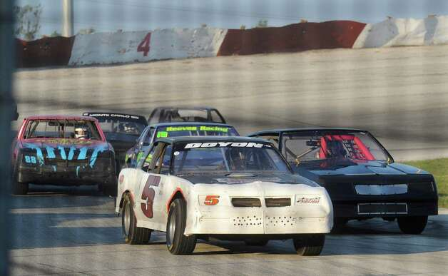 The field of racers enter the front stretch at the San Antonio Speedway on Texas Highway 16 South on Saturday, Oct. 20, 2012. The 35-year-old half-mile track has not hosted a race since 2007. Photo: Billy Calzada, Express-News / © 2012 San Antonio Express-News