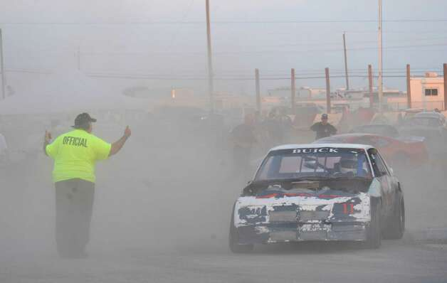 Competitors leave the dusty infield for the track at the San Antonio Speedway on Texas Highway 16 South on Saturday, Oct. 20, 2012. The 35-year-old half-mile track has not hosted a race since 2007. Photo: Billy Calzada, Express-News / © 2012 San Antonio Express-News
