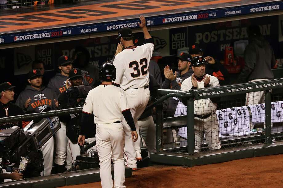 Ryan Vogelsong (32) had plenty to celebrate with Giants teammates after his Game 2 win and hopes for similar results tonight against the Cardinals. Photo: Ezra Shaw / 2012 Getty Images
