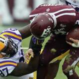 LSU defensive end Chancey Aghayere pulls Texas A&M quarterback Johnny Manziel's face mask during the fourth quarter of a NCAA football game, Saturday, Oct. 20, 2012, in College Station. LSU won 24-19.