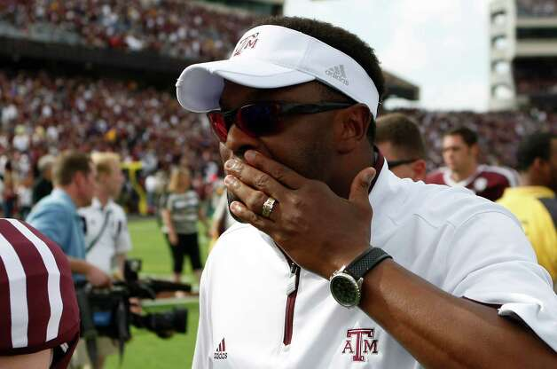 Texas A&M head coach Kevin Sumlin wipes his face as he walks off the field after loosing to LSU 24-19, Saturday, Oct. 20, 2012, in College Station. Photo: Nick De La Torre, Houston Chronicle / © 2012  Houston Chronicle