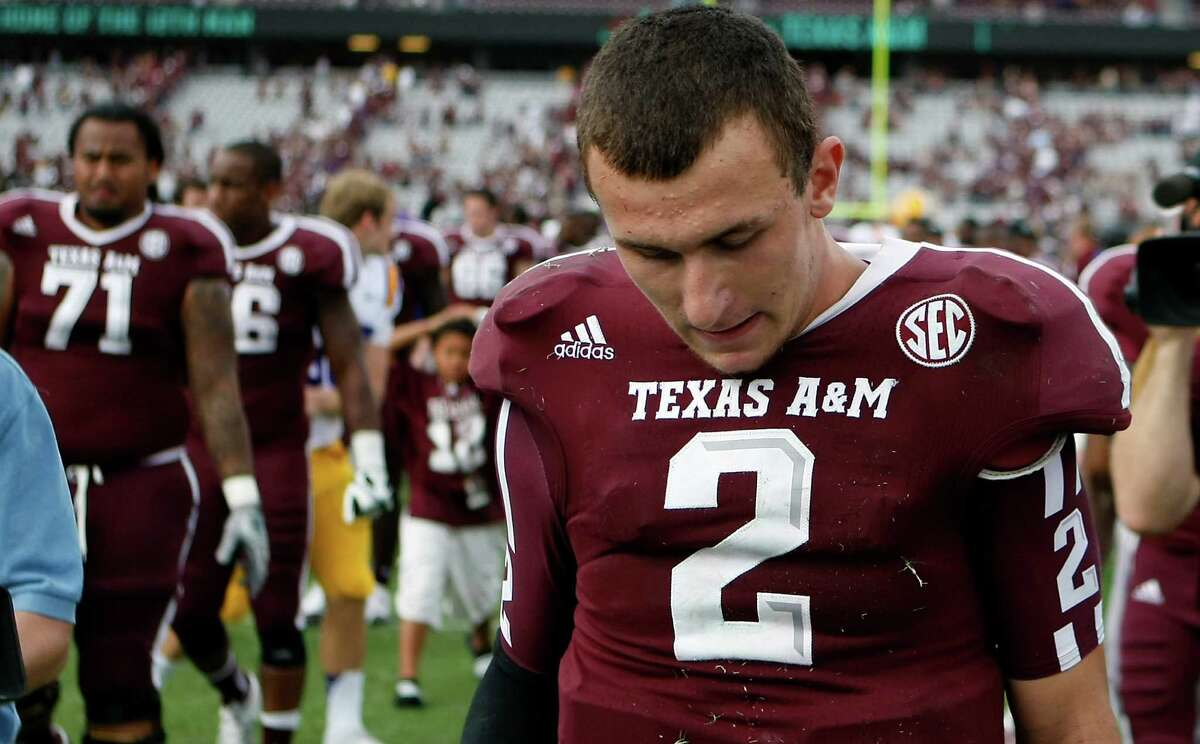 Texas A&M quarterback Johnny Manziel walks off the field after loosing to LSU 24-19, Saturday, Oct. 20, 2012, in College Station.
