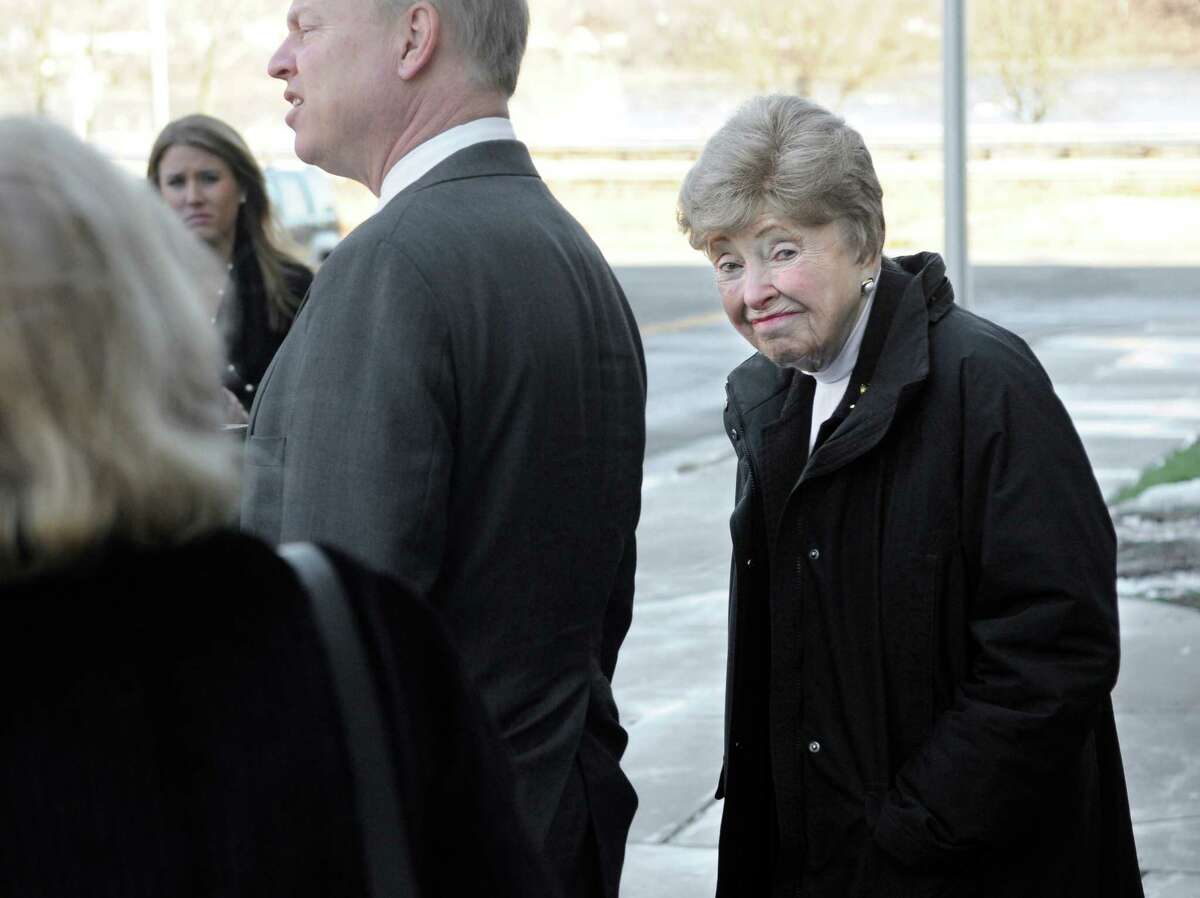Dorthy Moxley, mother of Martha Moxley, right, looks back while her son John speaks to the media outside court after a sentence review hearing for Michael Skakel in Middletown, Conn., Tuesday, Jan. 24, 2012. Skakel is seeking a reduction in his sentence of 20 years to life in prison for killing his neighbor Martha Moxley.