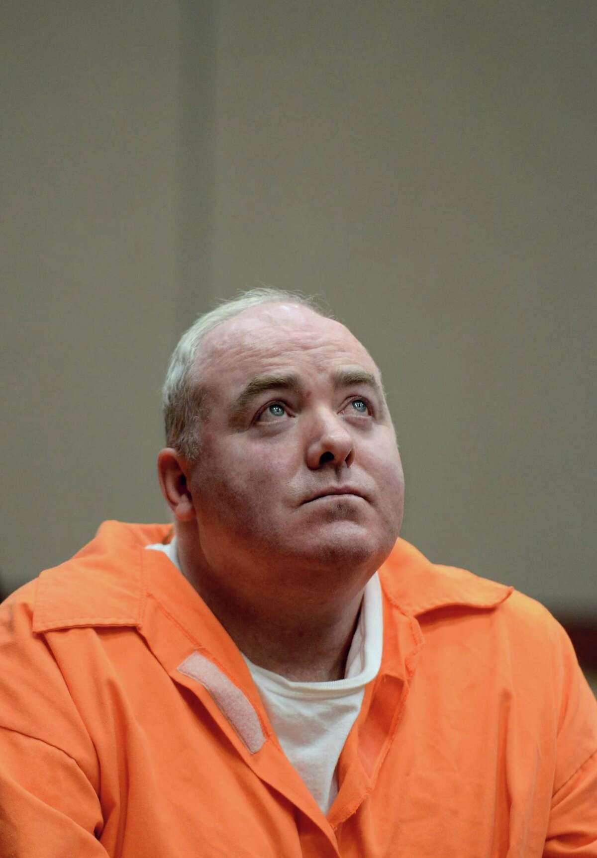 Michael Skakel looks up while listening to a statement from John Moxley, brother of victim Martha Moxley in court in Middletown, Conn., Tuesday, Jan. 24, 2012. Skakel has a parole board hearing scheduled for Wednesday, Oct. 24, 2012. (AP Photo/Jessica Hill, Pool)