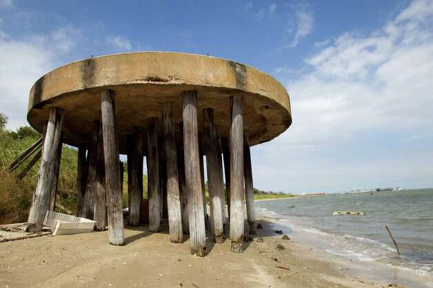 An abandoned structure sits on the beach on Pelican Island Thursday, Oct. 18, 2012, in Galveston. Photo: Brett Coomer, Houston Chronicle / © 2012 Houston Chronicle
