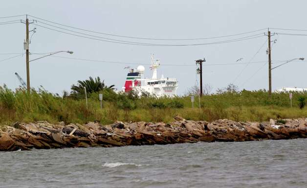 A ship sails out of Galveston Bay past Pelican Island Thursday, Oct. 18, 2012, in Galveston. Photo: Brett Coomer, Houston Chronicle / © 2012 Houston Chronicle