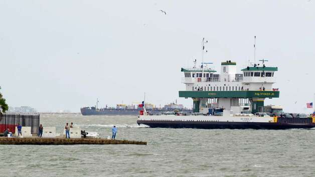The Bolivar ferry sails past people fishing off Seawolf Park on Pelican Island Thursday, Oct. 18, 2012, in Galveston. Photo: Brett Coomer, Houston Chronicle / © 2012 Houston Chronicle