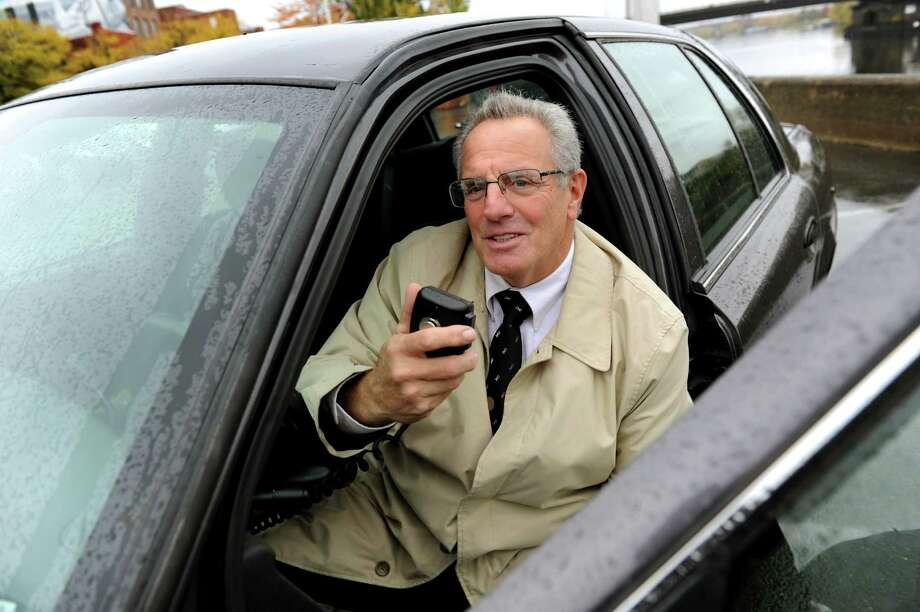 Troy Mayor Lou Rosamilia on the radio in his 2006 Crown Victoria unmarked police car. Rosamilia is one of at least three local elected leaders who drive take-home cop cars. (Cindy Schultz / Times Union) Photo: Cindy Schultz / 00019764A