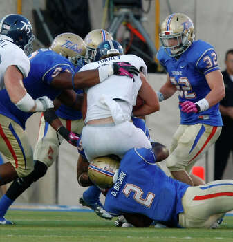 Tulsa's DeAundre Brown (2) tackles Rice's Luke Turner during the second half of an NCAA college football game Saturday, Oct. 20, 2012, in Tulsa, Okla. Photo: Tom Gilbert, Associated Press / Tulsa World