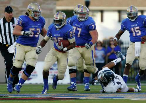 Tulsa's Ja'Terian Douglas runs for 75 yards during the second half against Rice during an NCAA college football game Saturday, Oct. 20, 2012, in Tulsa, Okla. Photo: Tom Gilbert, Associated Press / Tulsa World