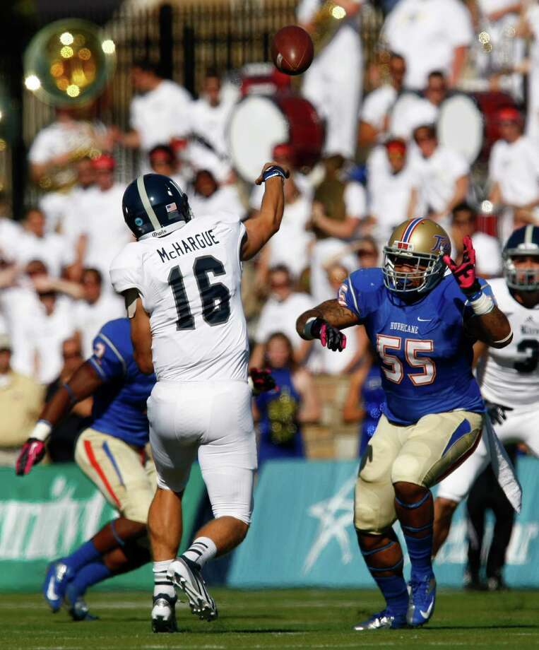 Rice's Taylor McHargue throws a pass as Tulsa's Shawn Jackson defends during the first half of an NCAA college football game Saturday, Oct. 20, 2012, in Tulsa, Okla. Photo: Tom Gilbert, Associated Press / Tulsa World