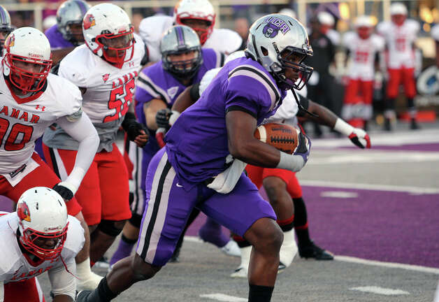 UCA running back Jackie Hinton pulls away from Lamar defenders in a Southland Conference football game Saturday, Oct. 20, 2012, in Conway, Ark. (Central Arkansas sports information)