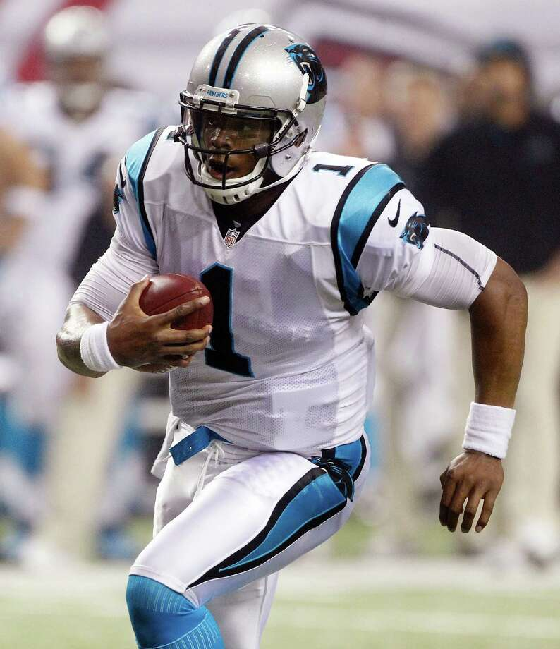 Panthers quarterback Cam Newton will lead the way against the Cowboys, who own an eight-game winning streak over Carolina. Photo: John Bazemore / AP