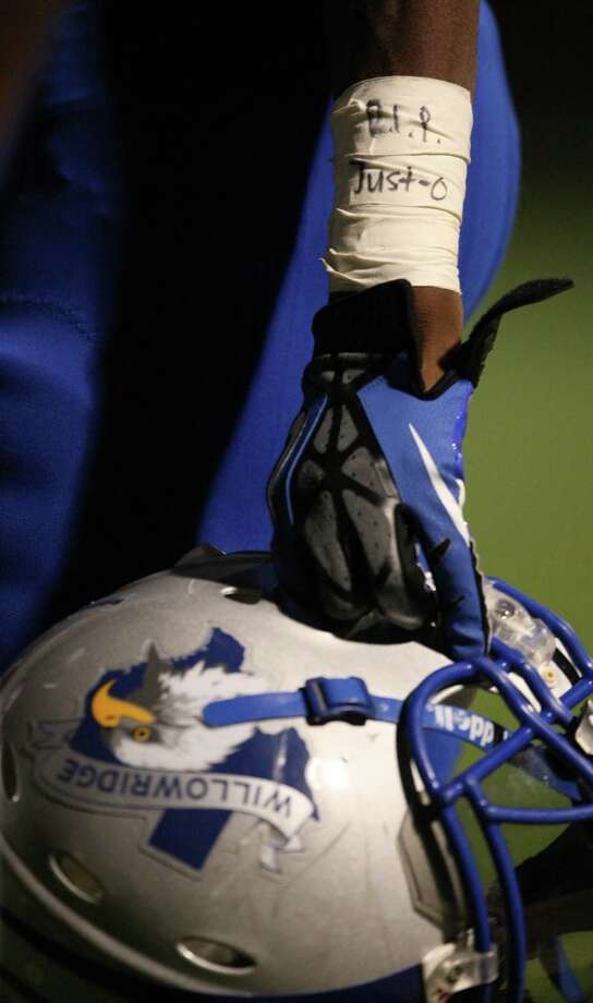 Willowridge wide receiver Quinton Campbell hold his helmet on the sidelines with a tribute to his brother, Justin, who was murdered last year during the second half of a high school football game against Ridge Point, Saturday, October 20, 2012 at Hall Stadium in Missouri City, TX. Photo: Eric Christian Smith, For The Chronicle