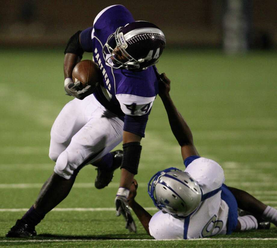 Ridge Point fullback Josh Burrell (44) escapes the tackle of Willowridge defensive back Nathan Hagan during the second half of a high school football game, Saturday, October 20, 2012 at Hall Stadium in Missouri City, TX. Photo: Eric Christian Smith, For The Chronicle