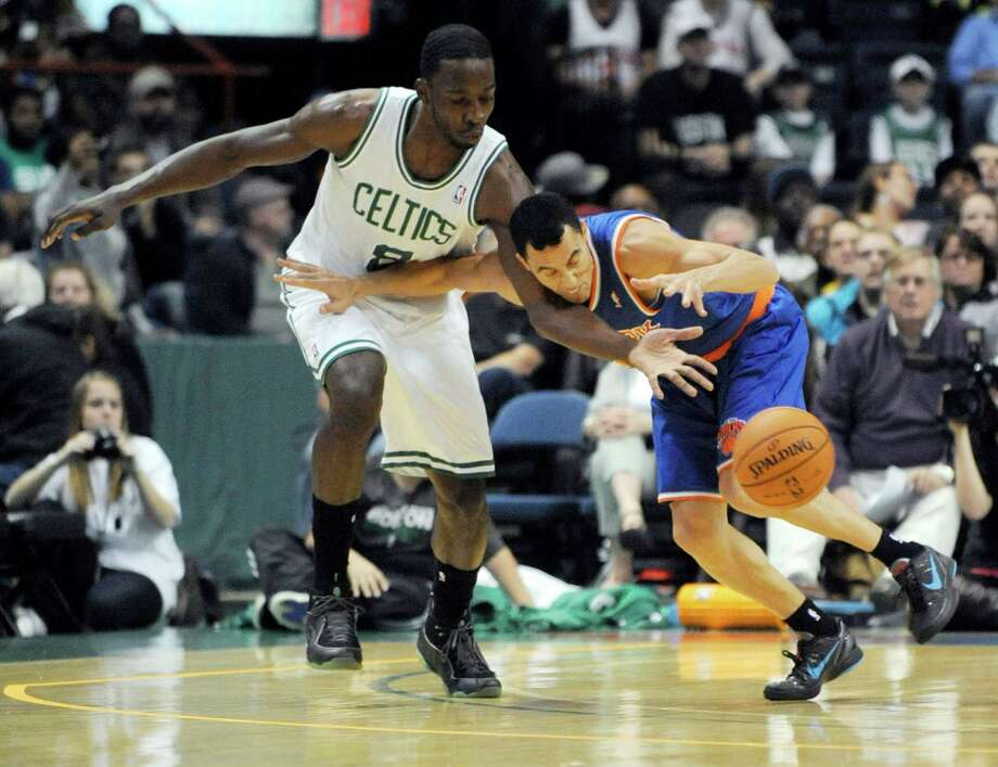 Boston Celtics' Jeff Green (8), knocks the ball away from New York Knicks' Pablo Prigiono, right, during the first half of an NBA preseason game in Albany, N.Y. on Saturday, Oct. 20, 2012.   (AP Photo/Tim Roske) Photo: TIM ROSKE