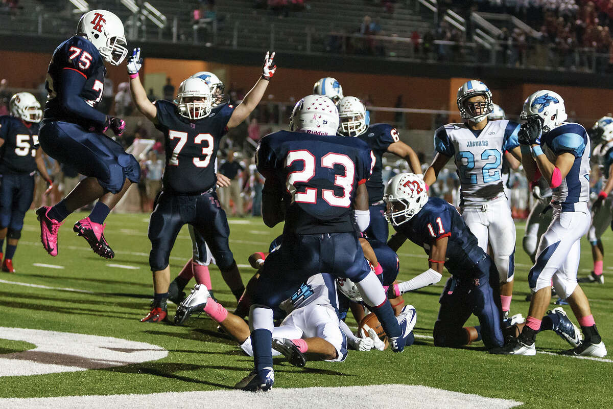 The Roosevelt Rough Riders celebrate their 34-27 overtime victory over Johnson as Steven Marshall scores on a four-yard run during their game at Heroes Stadium on Oct. 20, 2012. MARVIN PFEIFFER/ mpfeiffer@express-news.net
