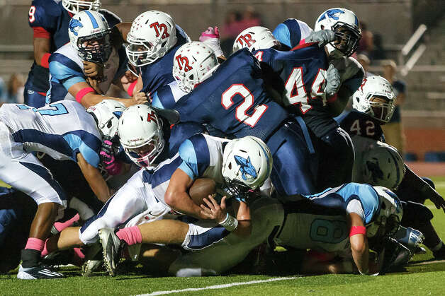 Johnson quarterback Hunter Rittimann (center) scores on a one-yard keeper with 2:44 remaining in their game with Roosevelt at Heroes Stadium on Oct. 20, 2012.  Roosevelt won the game 34-27 in overtime.  MARVIN PFEIFFER/ mpfeiffer@express-news.net Photo: MARVIN PFEIFFER, Express-News / Express-News 2012