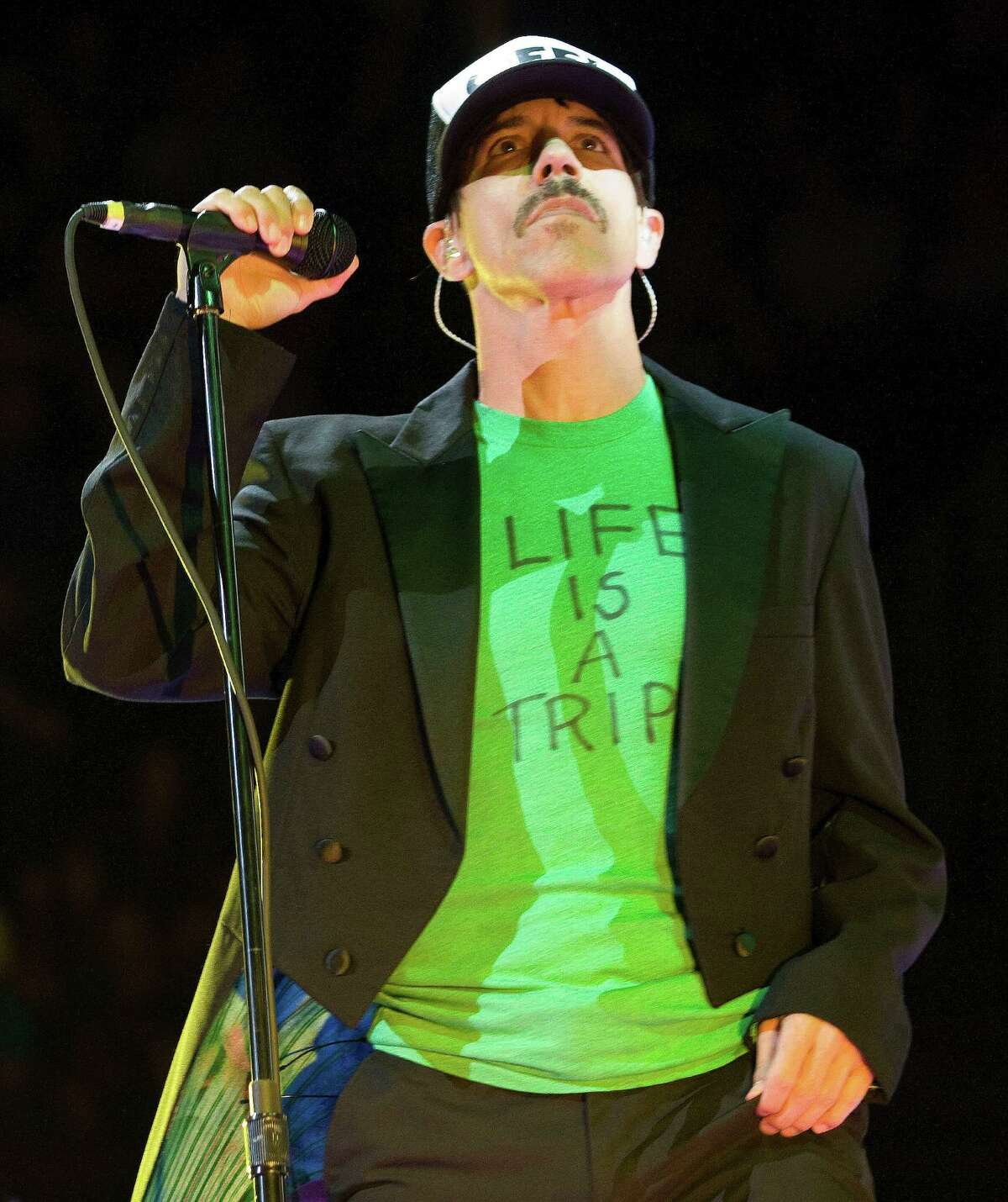 Anthony Kiedis of the Red Hot Chili Peppers sing the hit song Californication at Toyota Center on Saturday, Oct. 20, 2012, in Houston.