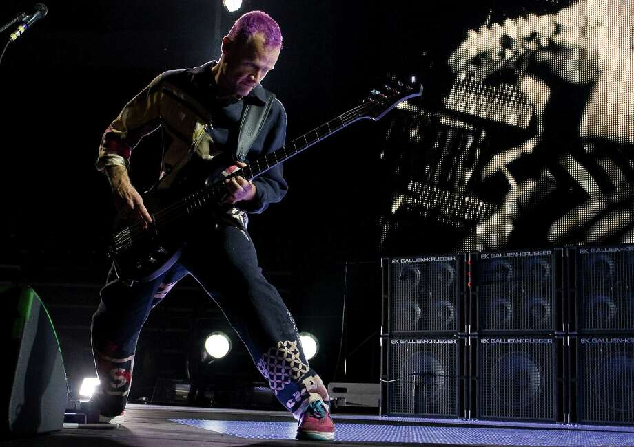 "Michael ""Flea"" Balzary of the Red Hot Chili Peppers performs at Toyota Center on Saturday, Oct. 20, 2012, in Houston. Photo: Joe Buvid, For The Chronicle / © 2012 Joe Buvid"