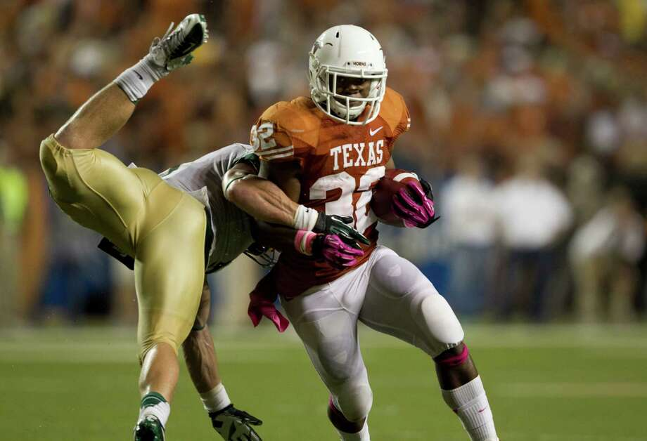 Texas running back Johnathan Gray gets past Baylor linebacker Eddie Lackey. Photo: Jay Janner, McClatchy-Tribune News Service / Austin American-Statesman