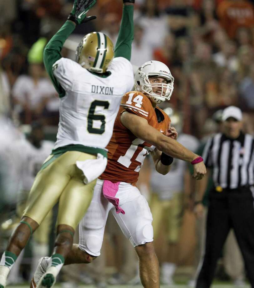 Texas quarterback David Ash passes under pressure from Baylor's Ahmad Dixon in the second quarter. Photo: Jay Janner, McClatchy-Tribune News Service / Austin American-Statesman