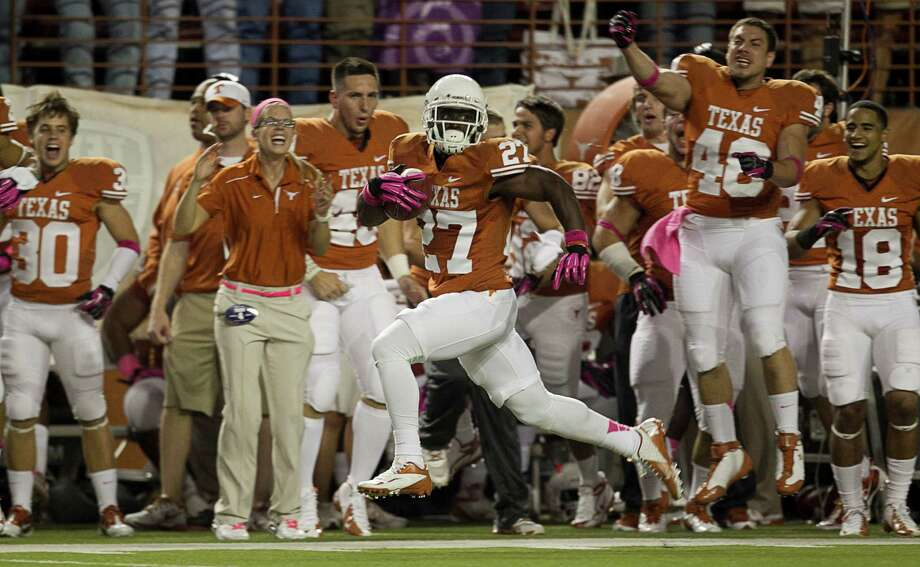 Texas running back Daje Johnson runs for a touchdown in the first quarter against Baylor. Photo: Jay Janner, McClatchy-Tribune News Service / Austin American-Statesman