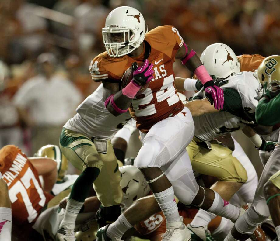 Texas's Joe Bergeron runs against Baylor in the first quarter. Photo: Jay Janner, McClatchy-Tribune News Service / Austin American-Statesman