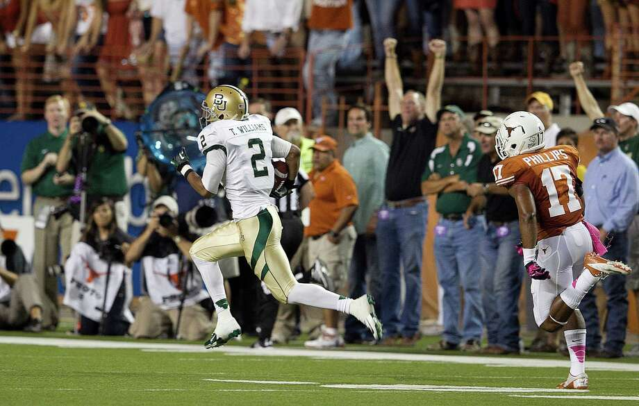 Texas's Adrian Phillips trails behind as Baylor's Terrance Williams heads to the end zone for a touchdown. Photo: Deborah Cannon, McClatchy-Tribune News Service / Austin American-Statesman