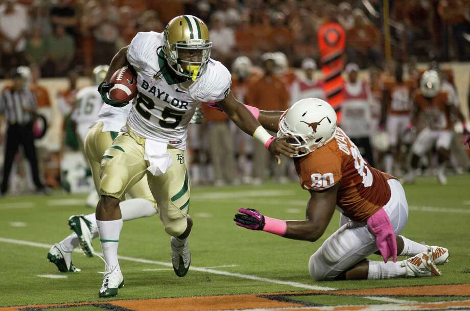 Lache SeastrunkBaylor running back20/1 oddsSeastrunk caused a stir when he said he planned to win the trophy in 2013. Photo: Jay Janner, McClatchy-Tribune News Service / Austin American-Statesman