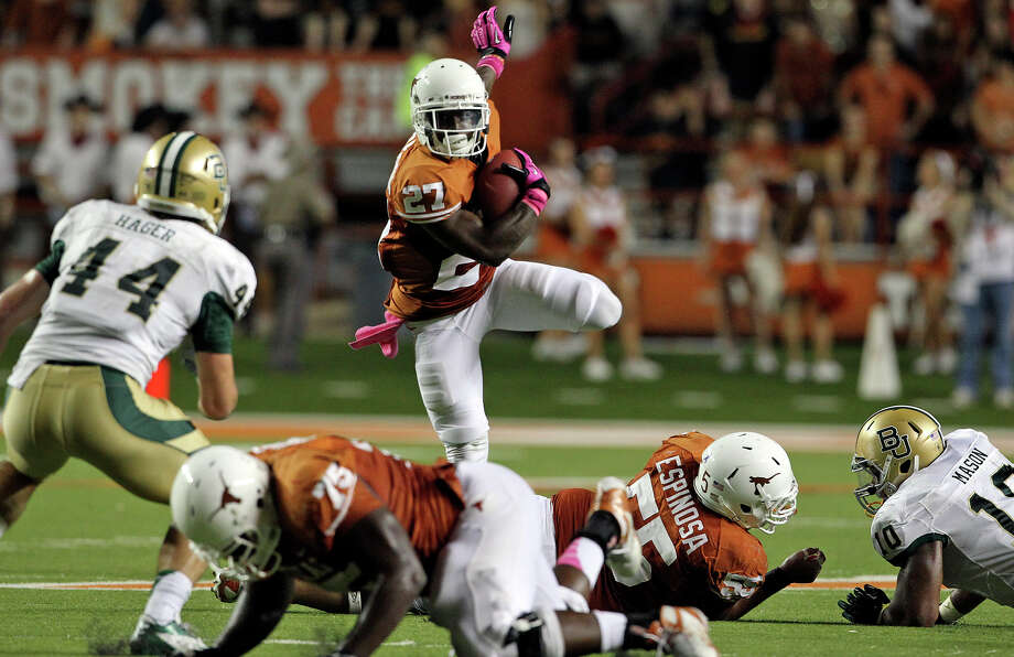 Daje Johnson pops up looking for running room on a return in the first quarter as Texas hosts Baylor at Darrell K Royal - Texas Memorial Stadium Stadium  on October 20, 2012. Photo: Tom Reel, Express-News / ©2012 San Antono Express-News