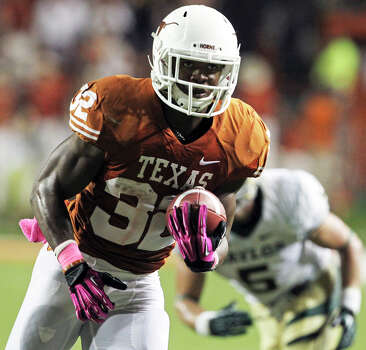Longhorn running back Johnathan Gray clears for a touchdown as Texas hosts Baylor at Darrell K Royal - Texas Memorial Stadium Stadium  on October 20, 2012. Photo: Tom Reel, Express-News / ©2012 San Antono Express-News