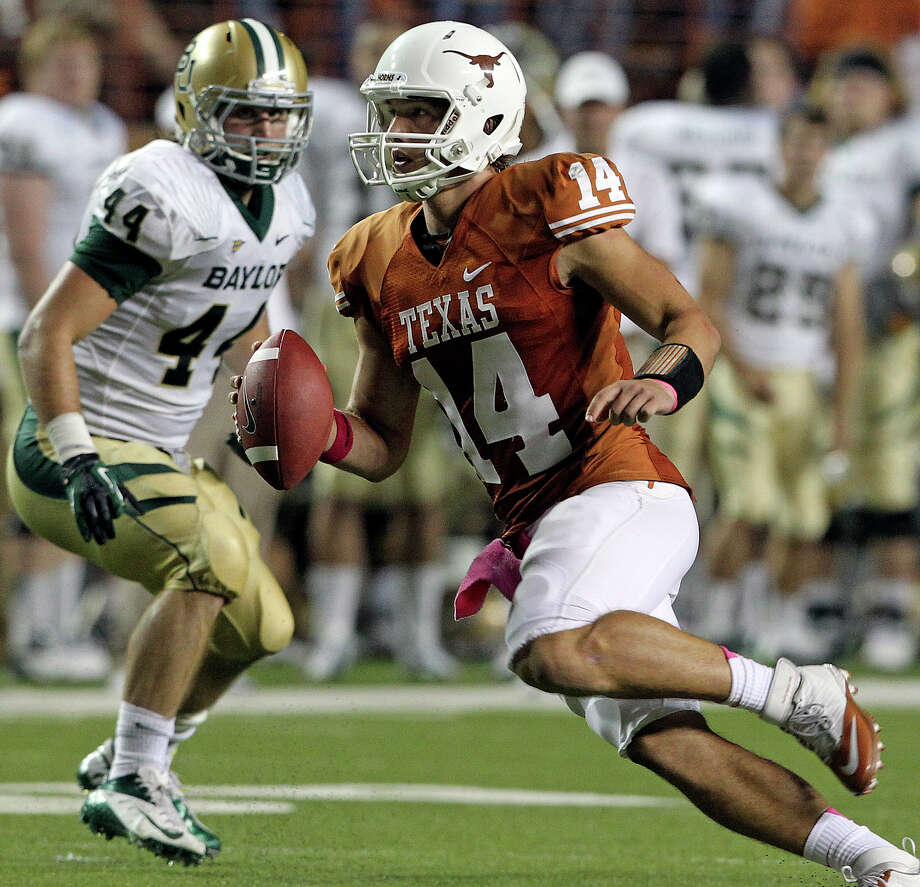 Longhorn quarterback David Ash rolls out of the backfield in the second quarter as Texas hosts Baylor at Darrell K Royal - Texas Memorial Stadium Stadium  on October 20, 2012. Photo: Tom Reel, Express-News / ©2012 San Antono Express-News