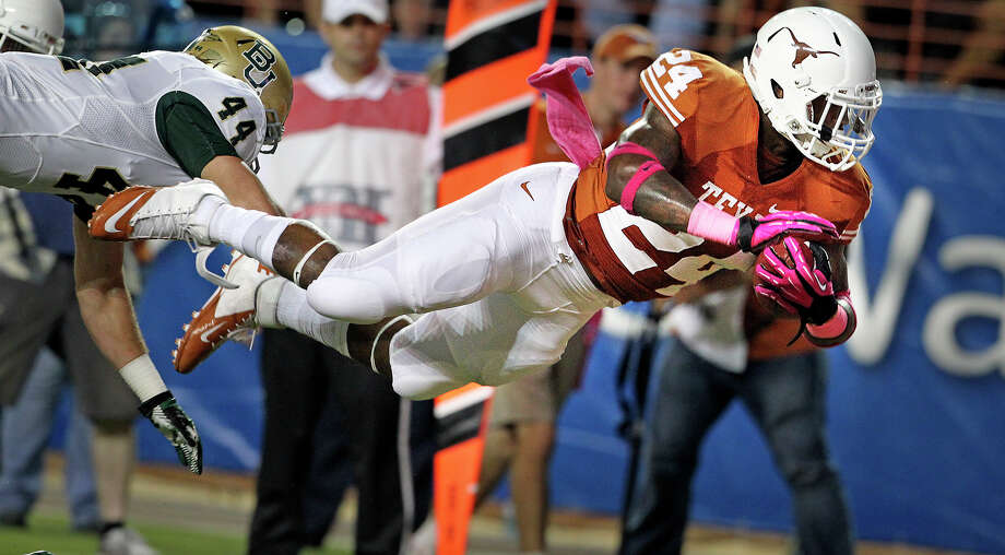 Longhorn running back Joe Bergeron flies in for a first quarter touchdown against Bryce Harper as Texas hosts Baylor at Darrell K Royal - Texas Memorial Stadium Stadium  on October 20, 2012. Photo: Tom Reel, Express-News / ©2012 San Antono Express-News