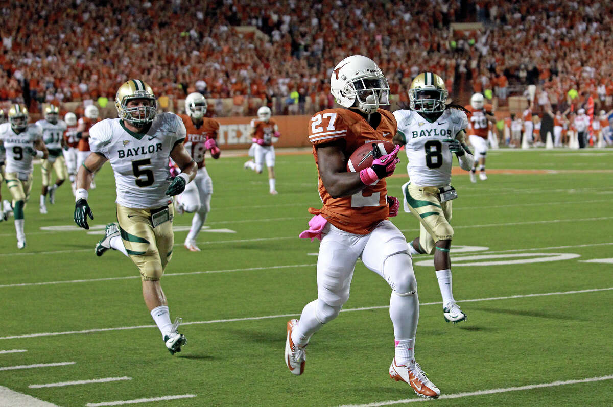 Daje Johnson leaves Baylor behind on a long touchdown run at the start of the game as Texas hosts Baylor at Darrell K Royal - Texas Memorial Stadium Stadium on October 20, 2012.