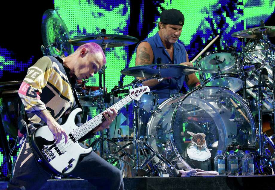 Bassist Flea and drummer Chad Smith of the Red Hot Chili Peppers perform Saturday night at the sold-out Toyota Center in Houston. Photo: Joe Buvid / © 2012 Joe Buvid