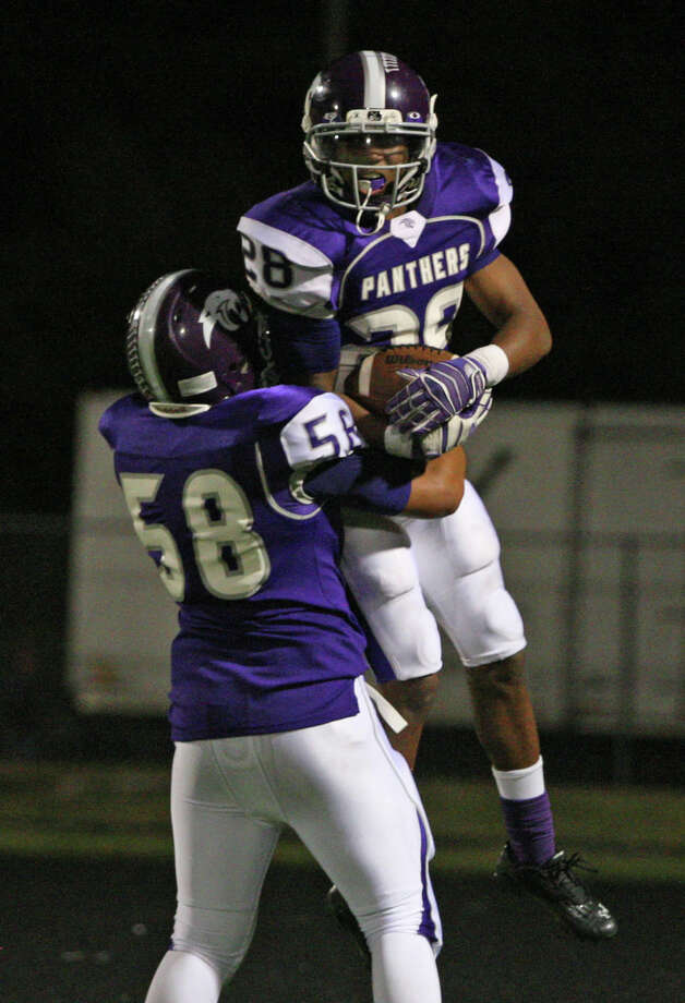 Ridge Point running back Je'Marcus Johnson gets a lift from offensive lineman Alain Lee after a 52-yard touchdown run. It was one of Johnson's five scores on the night in the Panthers' win. Photo: Eric Christian Smith