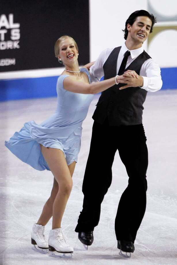 Canadian's Kaitlyn Weaver, left, and Andrew Poje skate during the ice dance short program. Photo: AP