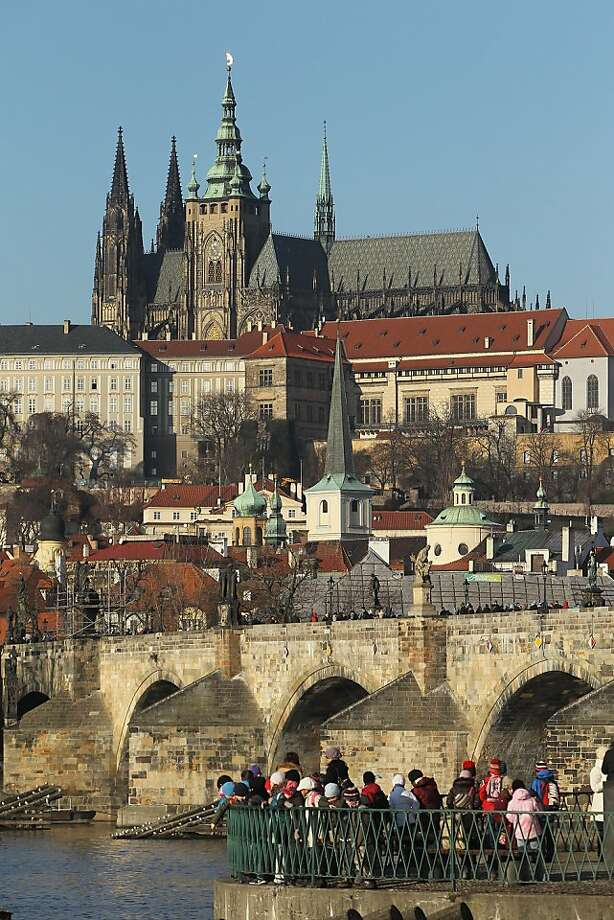 The Prague Castle - looming over Lesser Town district, Charles Bridge and Moldau River - is part of a complex that stretches a quarter mile with churches and palaces and spans one thousand years of history. Photo: Sean Gallup, Getty Images