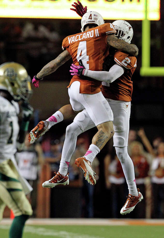 Longhorn defenders Kenny Vaccaro (4) and Mykkele Thompson celebrate a stop as Texas hosts Baylor at Darrell K Royal - Texas Memorial Stadium Stadium  on October 20, 2012. Photo: Tom Reel, Express-News / ©2012 San Antono Express-News