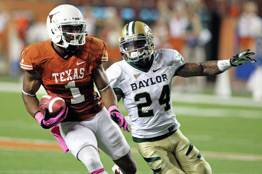 Longhorn receiver Mike Davis eludes Terrance Singleton (24) as Texas hosts Baylor at Darrell K Royal - Texas Memorial Stadium Stadium  on October 20, 2012. Photo: Tom Reel, Express-News / ©2012 San Antono Express-News