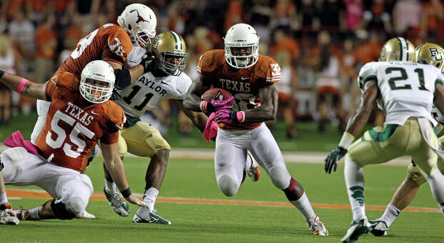 The Longhorns make a big hole for Johnathan Gray as Texas hosts Baylor at Darrell K Royal - Texas Memorial Stadium Stadium  on October 20, 2012. Photo: Tom Reel, Express-News / ©2012 San Antono Express-News