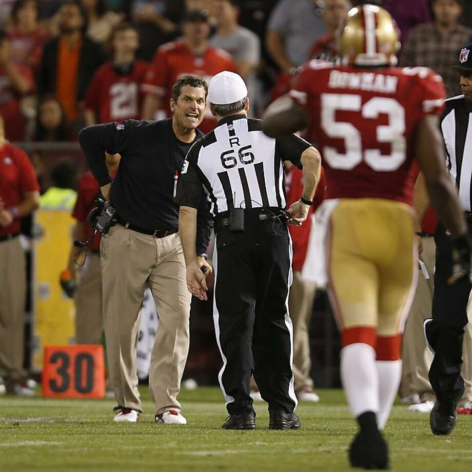 San Francisco 49ers Head Coach Jim Harbaugh argues a call with referee Walt Anderson during the fourth quarter against the visiting Seattle Seahawks at Candlestick Park in San Francisco, Calif. on Thursday, October 18, 2012. The 49ers defeated the Seahawks 13-6. Photo: Stephen Lam, Special To The Chronicle