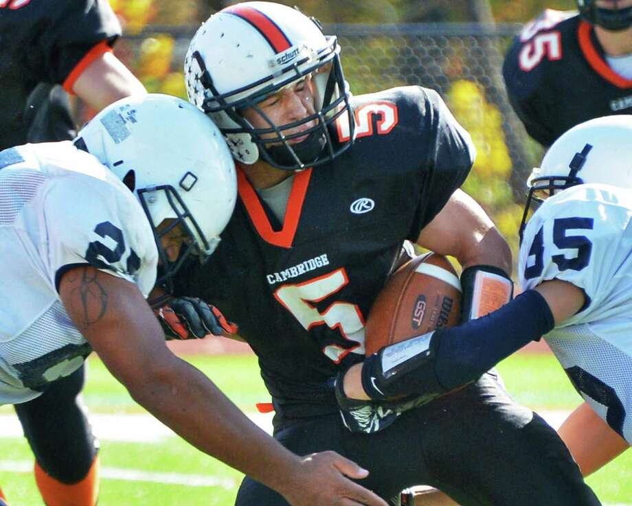 Cambridge's #5 Matt Parmenter gets hit by Rensselaer defenders #25, Seth Butler, left, and # 85 Tyler Stasack during Saturday's game at Stillwater High School Oct. 20, 2012.  (John Carl D'Annibale / Times Union) Photo: John Carl D'Annibale / 00019739A