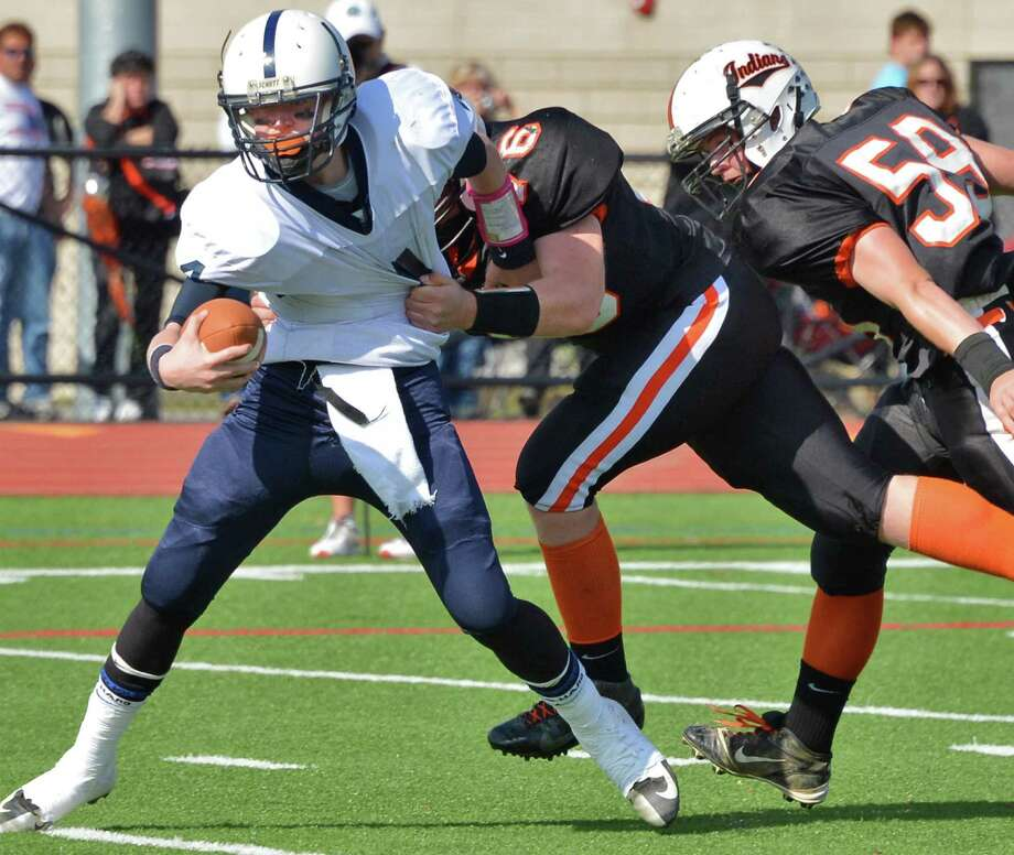 Rensselaer QB #4 Jake Forgea, left, pulls away from Cambridge defenders during Saturday's game at Stillwater High School Oct. 20, 2012.  (John Carl D'Annibale / Times Union) Photo: John Carl D'Annibale / 00019739A