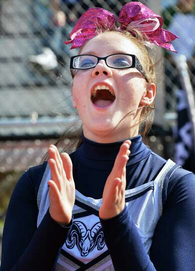 Rensselaer'High cheerleader Brittany Girgenti on the sidelines during Saturday's game with Cambridge