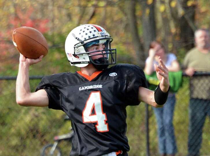 Cambridge QB #4 Ethan English gets off a pass against Rensselaer during Saturday's game at Stillwate